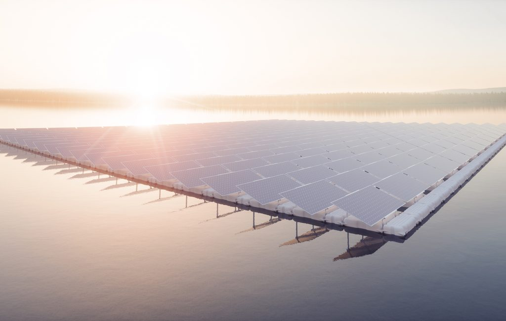 Aerial image of  floating solar power plant farm on calm lake  in beautifull sunset sunlight with misty forest landscape and cloudy sky in background. 3d rendering.